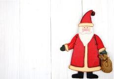 Cartolina di Natale Il Babbo Natale su priorità bassa bianca Fotografia Stock