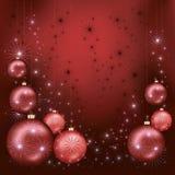 Cartolina di Natale luminosa con le sfere e le stelle Immagini Stock Libere da Diritti
