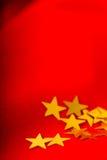 Cartolina di Natale Panno rosso con le stelle d'oro Fotografia Stock