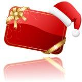 Cartolina di Natale rossa con il cappello della Santa Immagini Stock