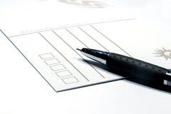 Cartolina e penna Fotografia Stock