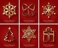 Cartoline d'auguri con i simboli dorati di Natale. Immagini Stock