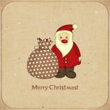 Cartoline di Natale con il fumetto Santa ed il regalo Fotografie Stock