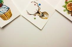 Cartoline di Natale dell'acquerello su un fondo bianco Immagine Stock
