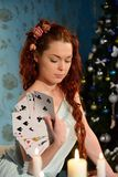 Cartomancy on Christmas Eve. Woman with cards on Christmas Eve Royalty Free Stock Photos