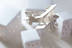 Carton Airplane over Carton City Stock Photos