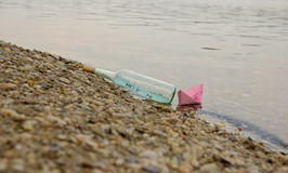 Carton Board with Message in the Bottle-Help Me Concept Royalty Free Stock Photography