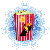 Carton bowl full of popcorn a picture of a Toucan Stock Images