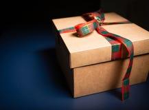 Carton box decorated with ribbon. Christmas theme. stock photos