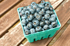 Carton box with fresh ripe blueberry Stock Images