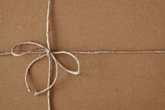 Carton box post package with bow Royalty Free Stock Images