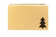 Carton box. Simple brown carton box with christmas tree symbol stock photo