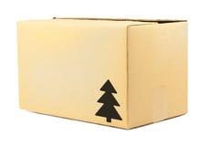 Carton box. Simple brown carton box with christmas tree symbol royalty free stock images