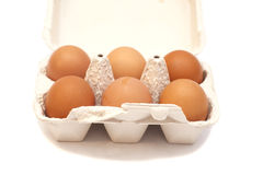 Carton box with six eggs Stock Photos