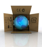 Carton box with world globe with america Stock Photos