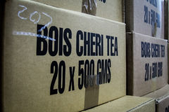 Carton boxes of Bois Cheri tea. In the factory, waiting for logistics Royalty Free Stock Photography