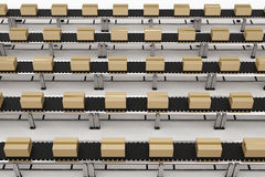 Carton boxes on conveyor belts Royalty Free Stock Photography
