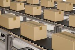 Carton boxes on conveyor belts Stock Photos