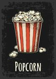 Carton bucket full popcorn with title. Royalty Free Stock Images