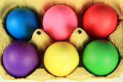Carton of colorful eggs Royalty Free Stock Images