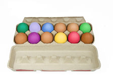 Carton of colorful eggs Royalty Free Stock Photography