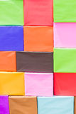 Carton with colorful papers background. Created by school children Stock Photography
