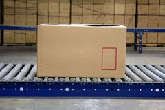 Carton on conveyor Royalty Free Stock Photo