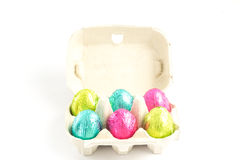 Carton with easter eggs Stock Images