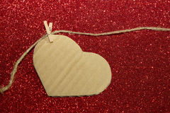 Carton heart on the red shining background Stock Image