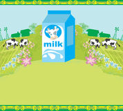 Carton of milk and cows graze in the meadow Royalty Free Stock Images