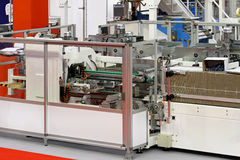 Carton packaging line. Carton packaging machine line in food factory Stock Image
