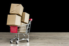 Carton parcel packages in shopping trolley Royalty Free Stock Photo