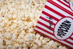 Carton of Popcorn. Box of popcorn being filled stock image