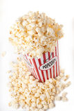 Carton of Popcorn. Overflowing carton of popcorn. Isolated against a white background royalty free stock photo