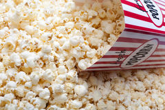 Carton scooping popcorn Stock Photo