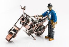 A carton worker and motocycle. Royalty Free Stock Photo