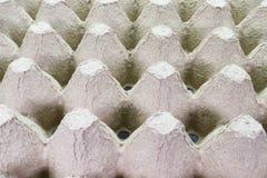 Cartone che imballa per le uova, pila della pila di carta, vassoio dell'uovo, fondo di struttura fotografia stock libera da diritti