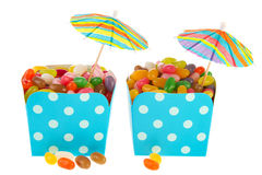 Cartons colorful candy with parasols Royalty Free Stock Photography