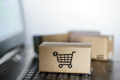 Cartons on computer keyboard. Online shopping, e-commerce concept