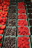 Cartons filled with fresh fruit at the local market Royalty Free Stock Photos