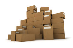 Cartons on a pile. Piles of cardboard boxes on a white background Royalty Free Stock Photos