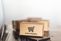 Cartons smartphone and laptop. Online shopping, e-commerce concept.  royalty free stock image