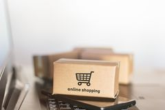 Cartons, smartphone and laptop. Online shopping, e-commerce concept.  royalty free stock images