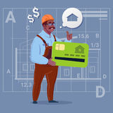 Cartoon African American Builder Hold Credit Card Sell House Real Estate Over Abstract Plan Background Male Workman. Flat Vector Illustration Royalty Free Stock Photos