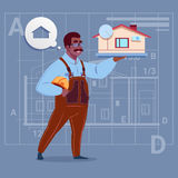 Cartoon African American Builder Holding Small House Ready Real Estate Over Abstract Plan Background Male Workman. Flat Vector Illustration Stock Images