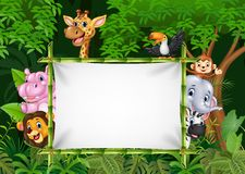 Cartoon african animals with blank sign Stock Photo