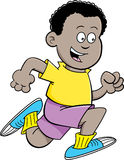 Cartoon African boy running Stock Photography