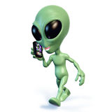 Cartoon alien cell phone. 3d rendering of a green cartoon alien walking and talking on a cell phone Royalty Free Stock Photography