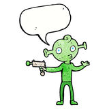 Cartoon alien with ray gun with speech bubble Royalty Free Stock Photo