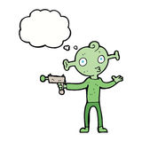 Cartoon alien with ray gun with thought bubble Stock Photography